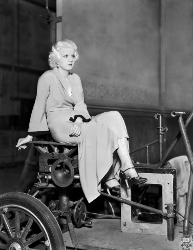 6th November 1931: Jean Harlow posing on a 'dolly' during filming of 'Beast of the City'.