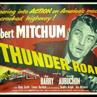 Robert Mitchum Just Naturally Eases Himself into Cool Movie Poster Art