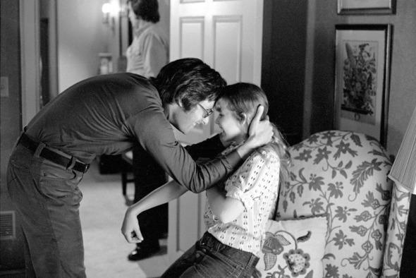 Medium BTS shot of director William Friedkin and Linda Blair as Regan MacNeil.